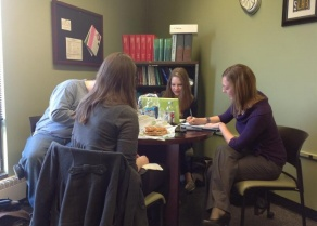 Library and Information Studies students studying together in the LIS student lounge.