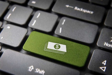 Black keyboard with green key with money symbol.