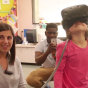 teacher with student using virtual reality.