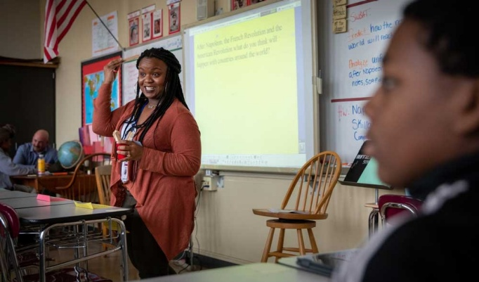 Sydney Favors stands before a history class at South Park High School and asks the students to consider what led citizens to rebel during the French and American revolutions.