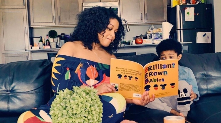 "GSE alumna, school psychologist and mother Desiree Williams, MA/AC '15, with her son Cortland, 4, and ""Brilliant Brown Babies,"" the book she wrote, illustrated and published to inspire children and their parents, now sells on Amazon. (Photo courtesy Desiree Williams)."