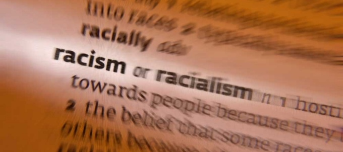 Image of the word and definition for racism in a dictionary.