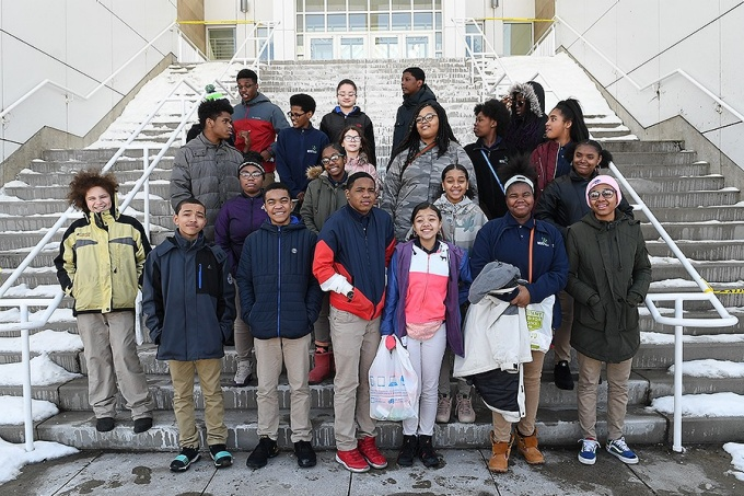 Eighth grade students from Enterprise Charter's Junior Frontiers of the Mohawk Valley program pose together on the steps of the Center for the Arts on UB's North Campus.